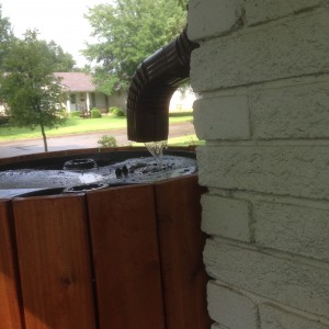 Rain! Downspout repositioned over intake hole, with filter